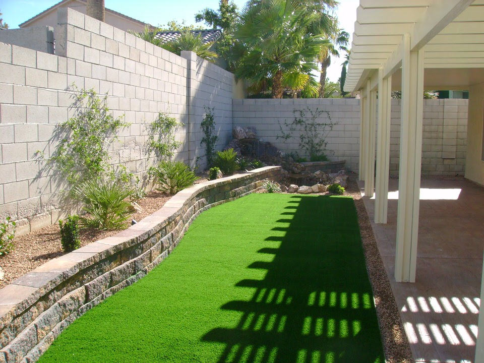 Las Vegas Backyard With Grass And A Low Brick Wall