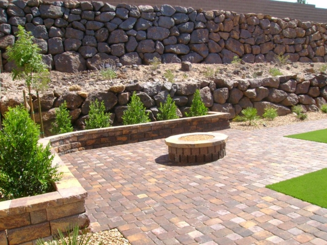 backyard with stone paving and small rock wall