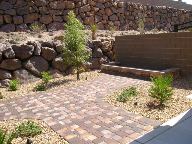 stone paving in backyard with plants