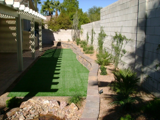 backyard with patio and grass