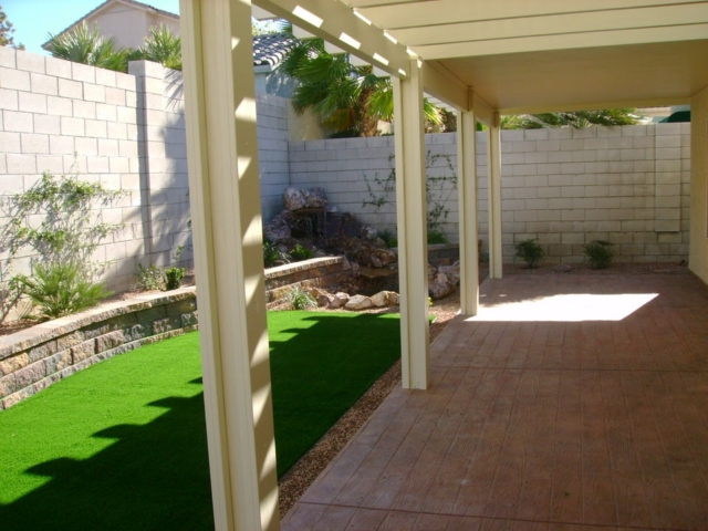 backyard with grass and a patio