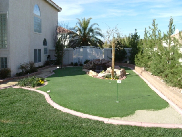 backyard with grass and golf course