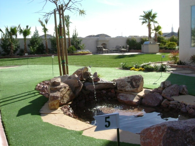 Las Vegas backyard with grass and a pond